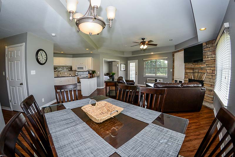 2 Bedroom villa dining table, living room and kitchen.