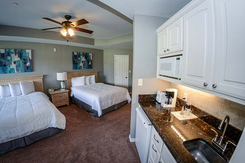 Queen villa with two beds and kitchenette.