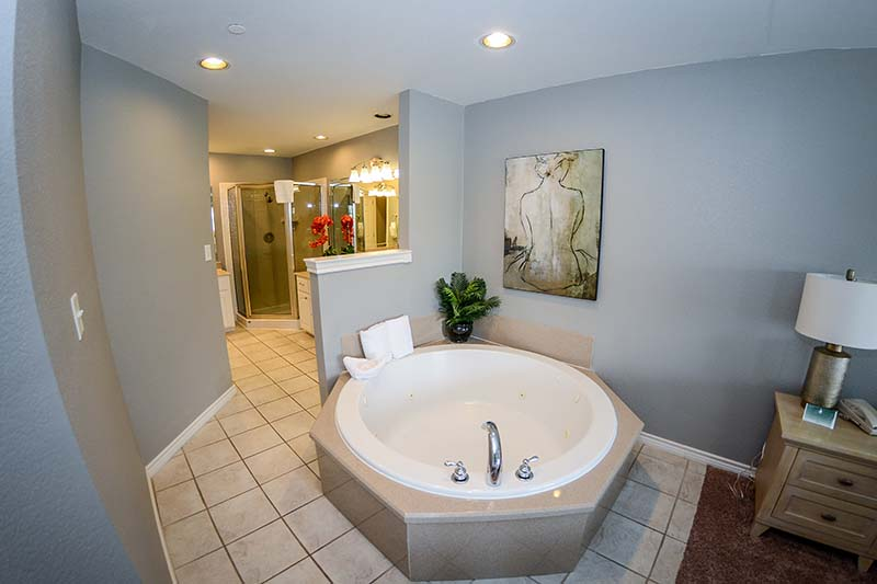 Villa bathroom with shower.and jacuzzi tub.