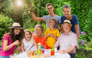 A family is gathered around a table during a family reunion.