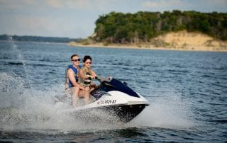 Photo of a Couple Jet Skiing—One of the Best Things to Do at Lake Texoma.