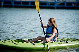 Photo of a Young Girl Kayaking—One of the Best Things to Do at Lake Texoma.