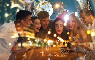 Group of friends celebrate a birthday at Tanglewood Resort during a night at the resort's steakhouse.